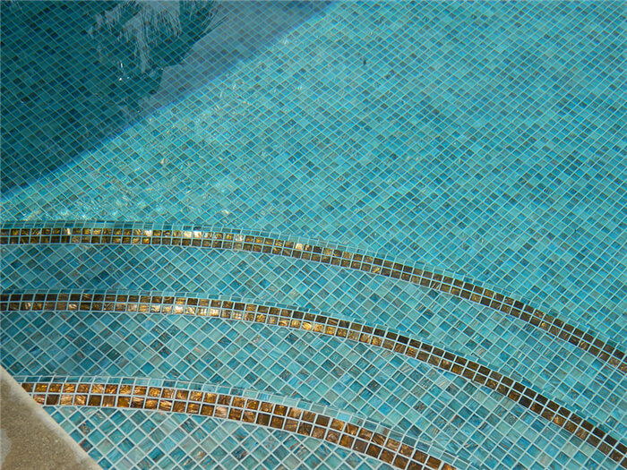 glass tiled pool using glass border tiles.jpg