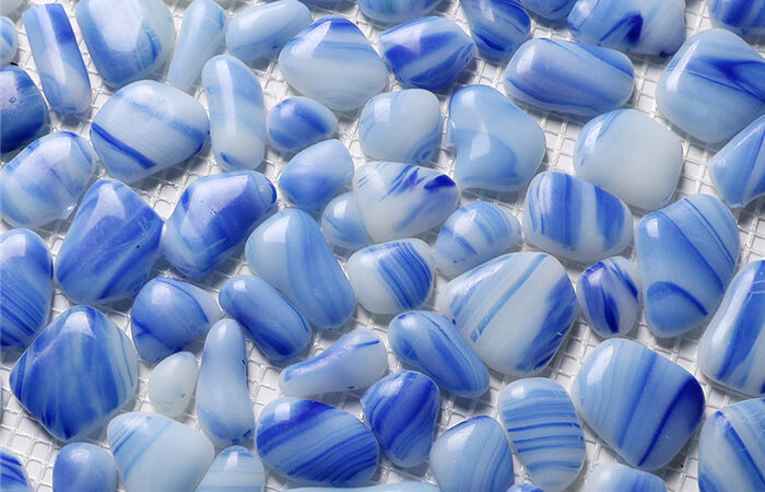 light blue glass made pebble shaped pool finish.jpg