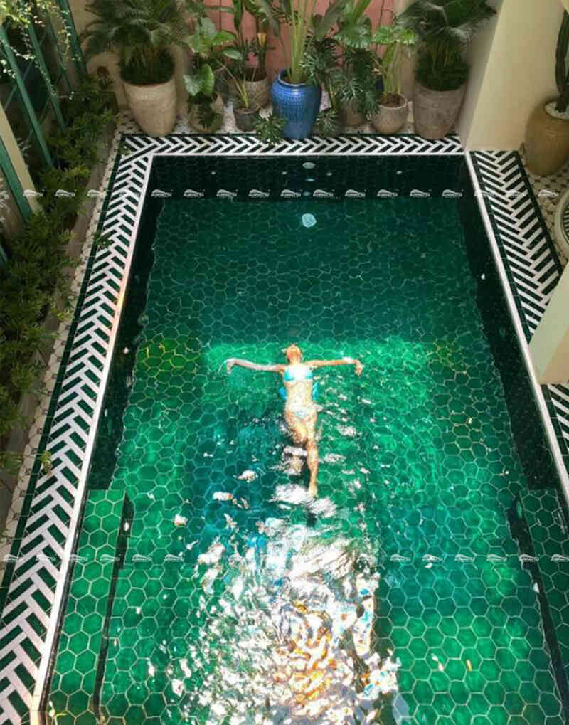 green swimming pool with porcelain pool tiles